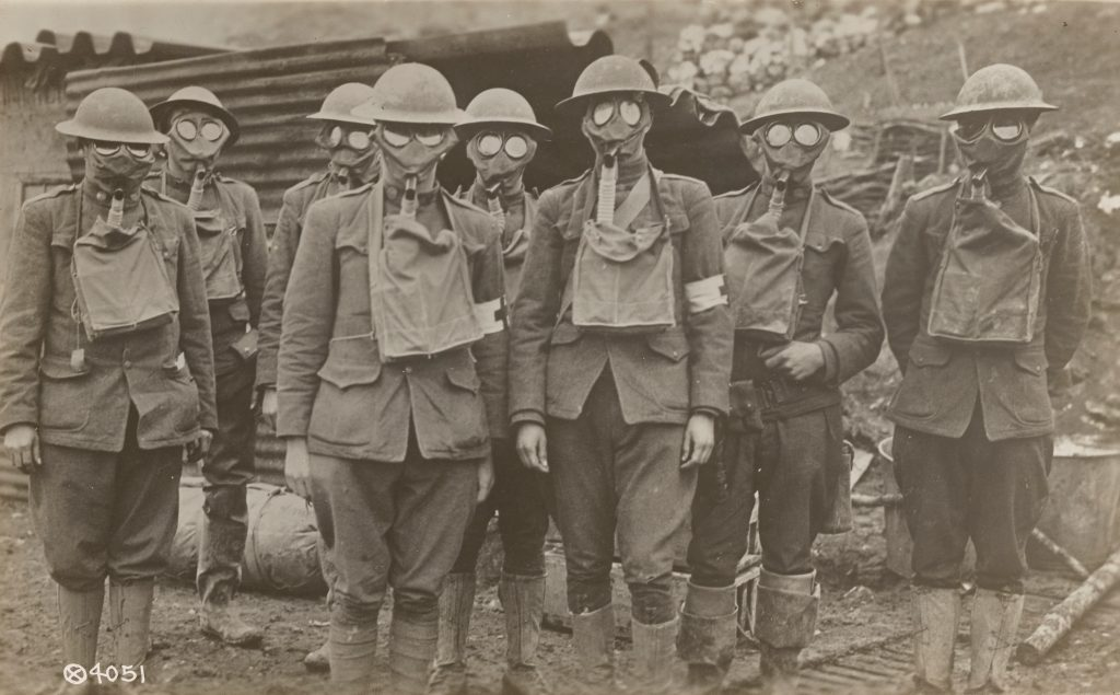 _American_soldiers_equipped_with_latest_type_gas_mask._-_NARA_-_55169506